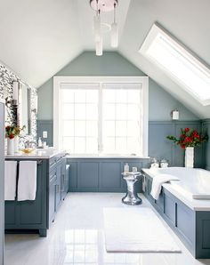 Brighten a dark, dull bathroom by adding windows or a skylight. Let your room's proportions and features dictate size. Under-the-eaves baths, for example, are great spaces for a skylight. #bathroomideas #bathroomremodel #newbathroom #bathroomdecor #bhg Attic Renovation, Attic Remodel, Attic Bathroom, Small Bathroom, Bathroom Plans, Washroom, Bathroom Ideas, Bathroom Paneling, Bathroom Marble