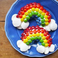 Mini Rainbow Cakes:  Arrange M&Ms candies on frosted doughnut half in rainbow color order.  Cut marshmallows and place at the cut ends of the doughnut for clouds.