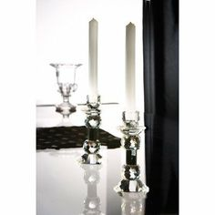 Fifth Avenue Crystal Zermat Black Ball Candle Holders, Set of 2 by Fifth Avenue Crystal. $40.20. Height: 8-inch. Crystal material. Set of 2, 2 candle holders. Enjoy these candle holders from Fifth Avenue Crystal Portico Collection. They come in a set of 2 and are made of crystal with black accents and has a sleek, contemporary design. Hand wash only with warm water and mild dishsoap.