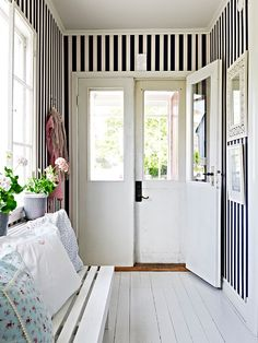 I am in love with this entry hall, mud room. The strips make it look so much larger and brighter. The double doors, I adore, and the use of a bench. Great Ideas