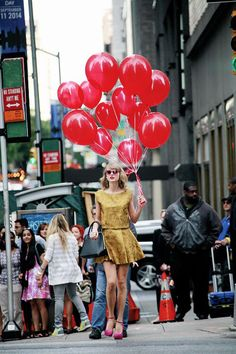 Just Taylor Swift roaming the streets with a bunch of balloons. Nothing out of the ordinary! I love her :)