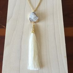 Druzy Stone Tassel Necklace Grey Stone and Ivory tassel. Chain is 30 inches long with a 3 inch extender. Charm is 5 1/2 inches. Same day or next day shipping. No trades and no holds. 20% off of bundles. Jewelry Necklaces