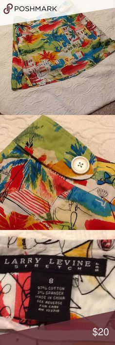 Larry Levine stretch tropical print skort Fun in the sun! Cute waistband with two big white buttons on the front. Front side pockets, side zipper. White background with blue, red, green, and yellow design. 97% cotton, 3% spandex; machine wash cold. Used condition with normal wear. Larry Levine Shorts Skorts