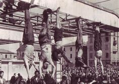 The dead body of Benito Mussolini next to his mistress Claretta Petacci and those of other executed fascists, on display in Milan on 29 April 1945, in Piazzale Loreto. The bodies, from left to right, are: Nicola Bombacci, Benito Mussolini, Claretta Petacci, Alessandro Pavolini and Achille Starace