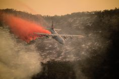 An Air National Guard C-130J Hercules aircraft equipped with the Modular Airborne Fire Fighting System drops a line of fire retardant on the Thomas Fire in the hills above the city of Santa Barbara, Calif., Dec. 13, 2017. The 146th Airlift Wing has been supporting CAL FIRE's efforts to battle the Thomas Fire raging in Southern California, and members of the New York Air Guard recently deployed to support the efforts. ANG photo by SSgt. Nieko Carzis.