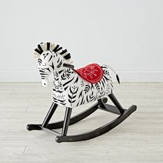 Shop Zebra Rocking Horse for Toddlers.  What's black and white and rocks? Our zebra rocker, of course.  (Okay, not our best joke…) The plush body, wooden base, and unique zebra design make it better than your average rocking horse.