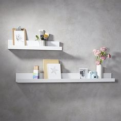 """Shop piano white wall shelf 24"""".   Super-chic white lacquered ledge with upturned edges and slim silhouette suspends photos, artwork and objects of interest with a polished point of view.  We love them staggered in the hall or greeting guests at the entry."""
