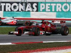 Alonso and Button out on track for Friday practice in Malaysia