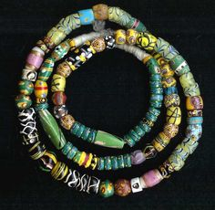 A strand of antique Venetian beads from the African trade circa late 1800's, early 1900's.