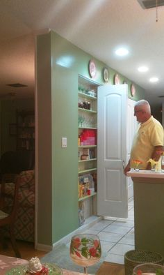 Love this idea of using space between the wall studs for storage. Living room is to the left and kitchen on the right. Photo taken from dining room table. This is a short dividing wall between rooms.