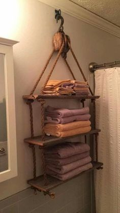 Rustic/industrial look: pully towel rack for the bathroom.