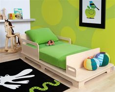 This is such a cute toddler bed! I love the bench at the end.