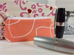 Fabric Lipstick Case Small Zippered Pouch by Phenomenal Women Shop. Fabric Lipstick Case, Small Zippered Pouch, Lip Balm Case, Earphones, Coins, USB Case, Keyring Attached, Free Charm, Orange, White Outlines.