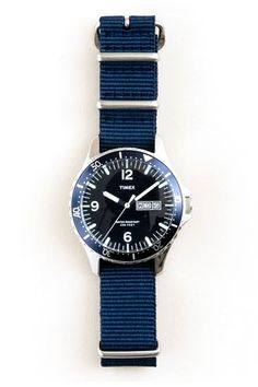 """A simple piece that can be seasonally updated with the switch of the strap."" Timex Andros Watch, $175, available at J. Crew."