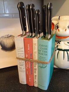 DIY knife block - Here the books are just glued together. The tight pages of the books hold the knives in place. I would replace the inside with wood so the books last longer and you Don't need the rope. (scheduled via http://www.tailwindapp.com?utm_source=pinterest&utm_medium=twpin&utm_content=post274885&utm_campaign=scheduler_attribution)