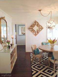 Add color, shape and pattern to a simple neutral Dining Room. Bright lumbar pillows on your chairs add comfort and style. Gold, silver and white accessories are perfect neutral pieces for adding your favorite colorful flowers and candles. HomeGoods Sponsored Pin.