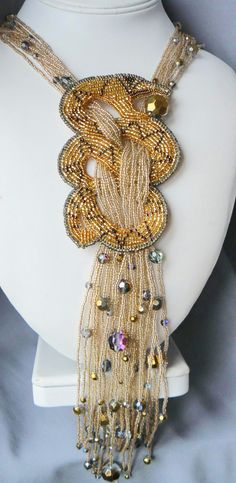 Natalia Bessonova is beadwork artist from Russia. She makes very interesting unique jewelry using freeform technic, bead embroidery, bead weaving and bead stringing technics