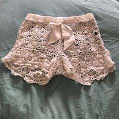 White lace shorts In perfect condition. Never worn. I got these for my recent trip to Santorini but decided not to bring them. Reasonable offers accepted. Will fit S-M. Got these from Anthropologie and are Cynthia Rrowley. Would love to bundle. Anthropologie Swim