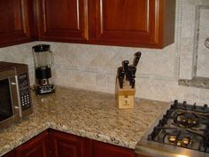 lightly colored backsplash for santa cecilia granite - Google Search
