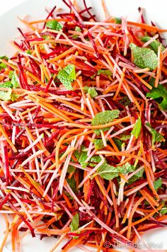 Healthy Recipes Carrot Beet and Apple Salad with Mint and Cumin Vinaigrette - This beet and apple salad is a similar to a mayo free coleslaw. The crisp carrots, beets and apple are a welcome departure from most winter salads. Raw Food Recipes, Vegetarian Recipes, Cooking Recipes, Healthy Recipes, Carrot Salad Recipes, Dinner Recipes, Healthy Salads, Easy Recipes, Summer Salads