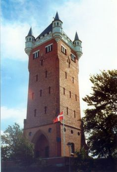 Esbjerg Water Tower in southwest Jutland, Denmark - photo by Stefan Kühn, via Wikipedia;  It was completed in 1897.  The red-brick water tower has many small windows and four decorative turrets at the top where there is a viewing platform.  It is now a museum with a permanent exhibition of Europe's water towers.