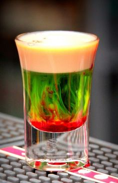 Fallen Froggie ~ 0.5 oz Midori Melon Liqueur, 0.5 oz Baileys Irish Cream, splash of Grenadine. Mix equal parts of Melon Liqueur and Baileys Irish Cream. Splash a bit of Grenadine on top.