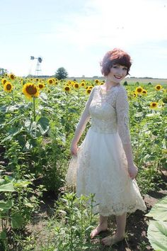 This just makes us happy. #sunflowers #lace #whitedress
