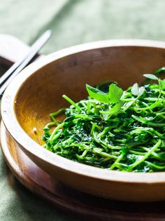 Chinese Stir Fried Pea Shoots (plus how to grow pea shoots) | recipe from Steamy Kitchen