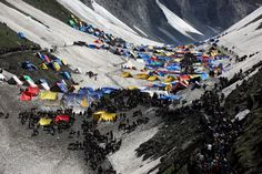 Hindu pilgrims, at a glacial campsite, proceed on the final stretch of their journey leading to the Amarnath Cave, June 27, 2012. Every year, hundreds of thousands of pilgrims trek through treacherous mountains in revolt-torn Kashmir, along icy streams, glacier-fed lakes and frozen passes, to reach the Amarnath cave, located at an altitude of 3,857 meters (12,729 feet), where a Shiva Lingam, an ice stalagmite shaped as a phallus and symbolizing the Hindu God Shiva, stands for…