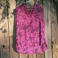 Magenta & black sleeveless top Brand new.  With tags. Never worn. Magenta based top with black floral design throughout entire top. V-neck opening with 5 buttons along the front. Size is XL. Worthington Tops Tank Tops