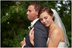 Bride embraces groom at Medina Country Club Wedding
