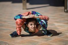 Gaza, Palestine. Mohammed al-Sheikh, 12, is so good at twisting his body he can walk while his legs are ben...