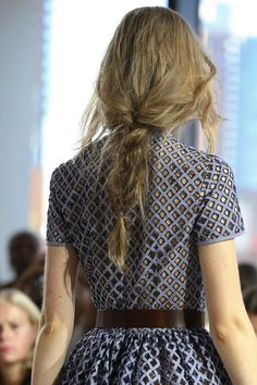 Loose braids worn at the Michael Kors show. A casual unkempt look for long hair. This looks great with the dresses at the show! #michaelkors #braids #messy