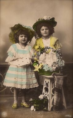 Edwardian Children, Best Friends Portrait in Fancy Costumes with Hat & Flowers, Original Rare 1900s German Hand Tinted Photo Postcard