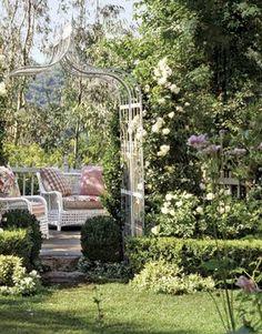 romantic garden arbor with seating