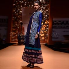 Navy blue long suit with geometric border.
