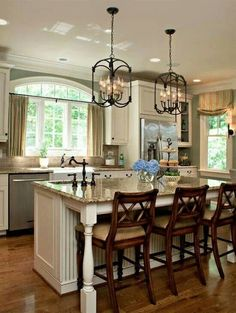 Kitchen - use of dark colors to contrast the light cabinets and the medium countertop