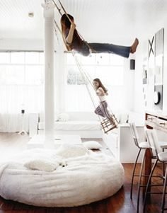 indoor swings and giant bean bag...yes please.