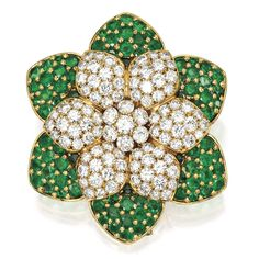 18 Karat Gold, Diamond and Emerald Brooch, Van Cleef & Arpels, France Designed as a flowerhead set with numerous round diamonds weighing approximately 10.80 carats, the exterior petals decorated with round emeralds, signed Van Cleef & Arpels, numbered 5329, with French assay and workshop marks. With signed box and pouch.
