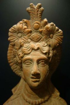 Terracotta bust of Isis; Egypt, Roman period, 10 BCE - 40 CE. Huntington Museum of Art.