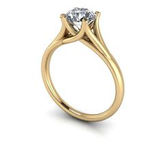A solitaire engagement ring set with a Russian Brilliants round cut stone of your choice. Shown with a 1.0 ct stone size. For more information regarding our gemstones please reference our FAQs. http:/