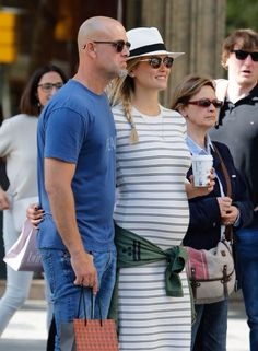 Model Bar Rafaeli with her husband expecting baby #1 in mid summer. Love the casual maternity style here.