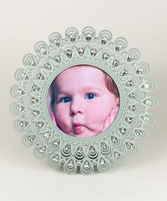 THE FRAME, not the nasty little brat in the middle... Loving this Light Blue Jeweled Frame on #zulily! #zulilyfinds