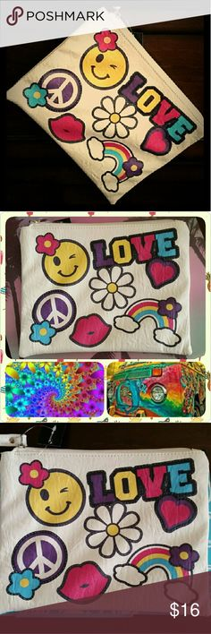Hippie Love Makeup Bag/Wristlet Cream makeup bag/wristlet w/ love and peace designs. Single zipper across top. 3rd pic shows bag atop a composition book for purpose of sizing/measurements. OMG! Accessories Bags Cosmetic Bags & Cases