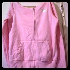 Pink Victoria's Secret hoodie heart on back Pink color silver doggie doggy .. Cuff sleeves .. Size large but fits smaller. Could fit medium and smaller. Hope on back in a black heart.. Love pink side neck collar. Missing drawstring normal fuzziness.. 60%cotton 40% polyester..slight fading on the heart. PINK Victoria's Secret Sweaters