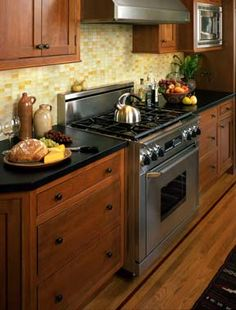 Gray laminate countertop and affordable countertop for Craftsman style kitchen faucets
