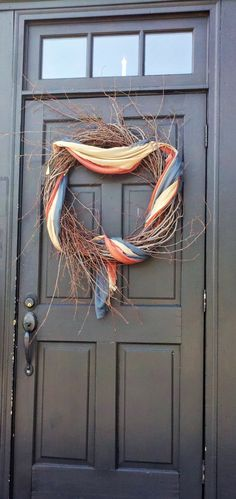 A grapevine wreath  and a primitive patriotic bunting.... yes!