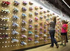 Marie White, one of the co-owners of Running Central, organizes the shoe shelf with employees at the new location at Illinois Antique Center. Running Central is now the biggest independently-owned running shoe store in the country. http://480degrees.com/