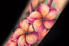 Super pretty plumeria (frangipani) tattoo by Liz Venom   Beautiful, delicate, feminine, amazing, best, superb, pretty, girly, women, girl, colour, color, leaves, vintage botanical, flower, foliage, oil, painting, tattoos, tattoo, tattooed, tattoo, ink, inked, crazy, realism, realistic, soft, bombshell, tattooer, artist. vivid, splendid, frangipanis, plumerias, tropical