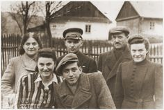 Group portrait of young Jewish men and women in the Wisnicz Nowy ghetto